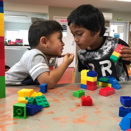 maori boys playing blocks